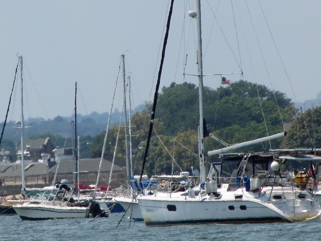 These boats are moored at the South Boston Yacht Club.