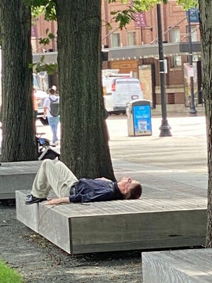 This man is getting some rest on a very nice day.