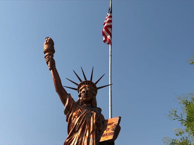 """A copper Statue of Liberty replica stands at the entrance of La Junta City Park, the venue for Saturday's """"Day of Remembrance"""" ceremony honoring Sept. 11 victims. The statue was unveiled by the Boy Scouts of America in 1951."""
