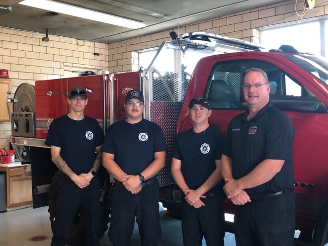 La Junta Fire Chief Brad Davidson (right) with three of his fire fighters. From left to right: Caulin Hulsey, Josh Mosher and Aaron Childers.
