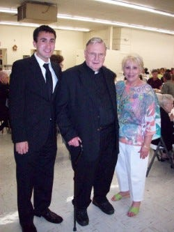 Rev. William Fisher (center), OSFS, attended a reception held in his honor at St. Joseph Parish Center following his retirement in 2012. With him are Nicholas Albano and Linda Compora, both members of the parish.