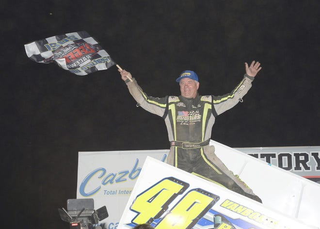 Darryl Ruggles celebrates his sixth track title at Canandaigua on Saturday.