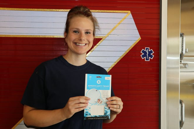 Jessica Melton, Nevada Fire Department risk reduction officer, holds up a package of the adhesive safety strips that will be given out to older residents as a prevention tool against slips, trips and falls.