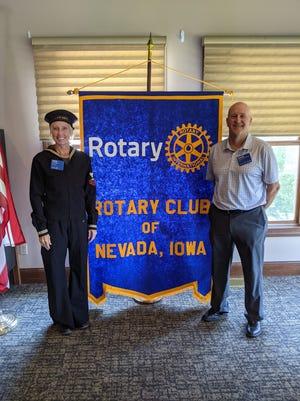 Nevada Rotary Club president, Emmi Miller, wearsher grandfather's WWII era Navy uniform, while Rotarian Bernie Stephenson portrays1940s club secretary, Elmer Schindler.
