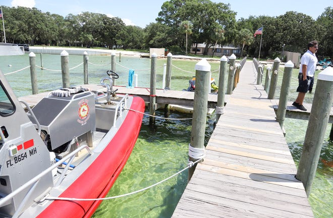 Destin Fire Control District Capt. Felix Romero watches boat traffic from the dock at the Destin Fire Control District's station on Calhoun Avenue.