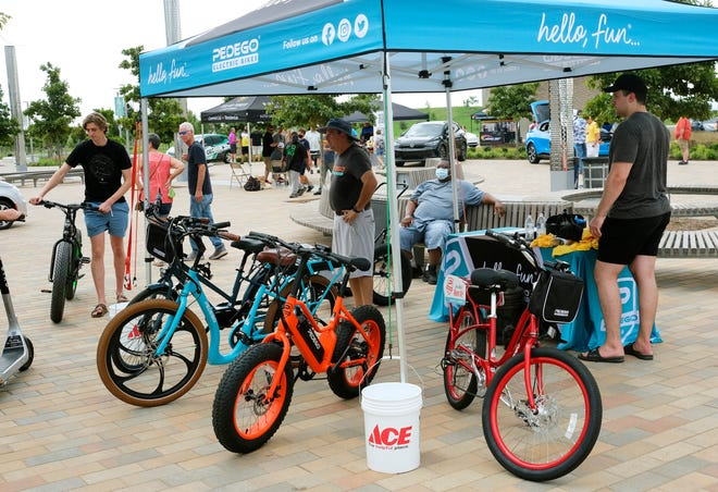 Electric bikes on display at the National Drive Electric Car Show in the Robinson Grove at Scissortail Park on Sept. 4. E-bikes are now allowed in Oklahoma City's parks and on city trails after an ordinance change by the city council.