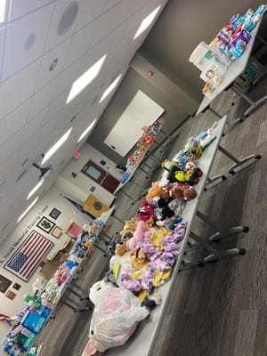 Stuffed animals and other supplies donated by community members for Afghan refugees