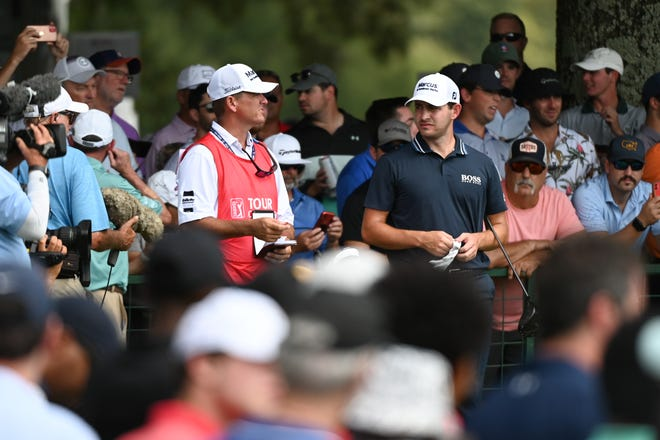 Patrick Cantlay talks to his caddie, Jupiter's Matthew Minister, on the 10th hole during the final round of the Tour Championship Sunday in Atlanta.