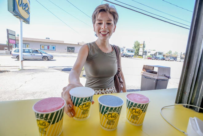 Amy Russo samples an assortment of flavors at the Del's mothership on Oaklawn Avenue in Cranston.
