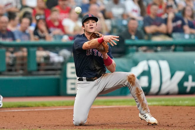 Red Sox third baseman Bobby Dalbec throws to first but not in time to get out the Indians' Bradley Zimmer in the second inning of a game on Aug. 27. Dalbec was charged with a throwing error and Zimmer advanced to second base.