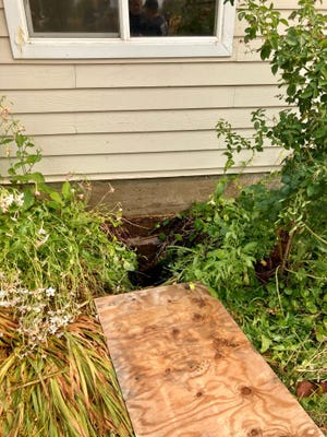 A Eugene man fell down this 16-foot sink hole next to the foundation of his home Tuesday, Sept. 7. 2021.