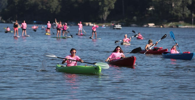 More than 80 people took part in Tuesday's second annual Paddle for Pink fundraiser at Lake Mohawk that raised money to help breast cancer survivors.