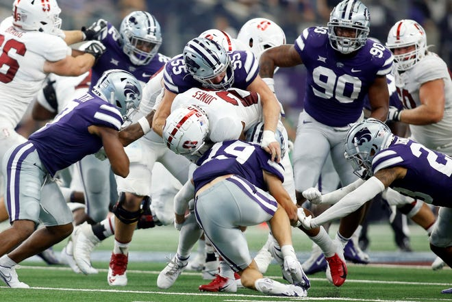 Kansas State linebackere Cody Fletcher (55) and safety Ross Elder (19) take down Stanford running back Austin Jones (20) during last Saturday's game in Arlington Texas. The Wildcats held Stanford to 39 rushing yards in a 24-7 victory.
