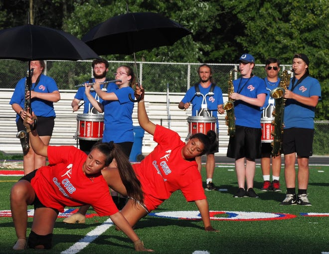 The Owen Valley Band & Guard recently completed their 2021 march-a-thon, putting in over nine hours practicing and perfecting this year's show, in the blistering Hoosier summer heat. The group ended their grueling day with a performance, displaying their progress, to friends & family in the stands. More photos from the event are featured in today's Spencer Evening World.