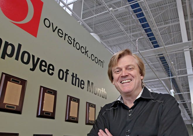 In this 2010 file photo, former CEO of OverStock.com Patrick Byrne poses at the company warehouse outside of Salt Lake City. A company Byrne is now associated with purchased $10 million worth of property in Sarasota County.