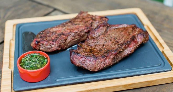 Grilled steak with chimichurri.