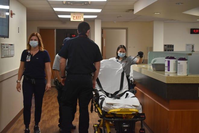 A nurse and REACT paramedics in the SSM Health St. Anthony Hospital-Shawnee Emergency Room.