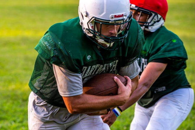 Dartmouth's Ethan Marques powers his way forward.