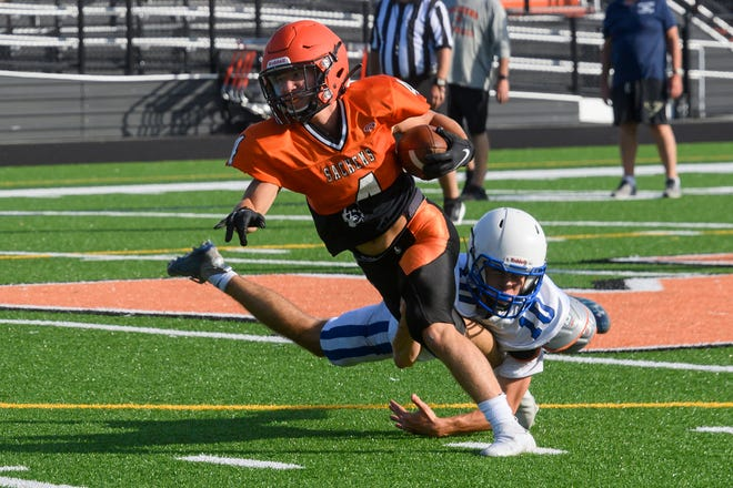 Middleboro's Matt Gwozdz gets around the end and picks up a few yards back on Aug. 31 during a scrimmage against Fairhaven. The Middleboro High School football team plays in their season opener Friday night (Sept. 10) against Apponequet at Griffith Field in Lakeville.