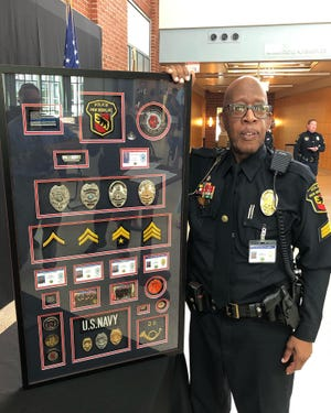 Sgt. William Hollowell holding his awards and recognitions after his retirement as an officer with New Bern PD on July 1.