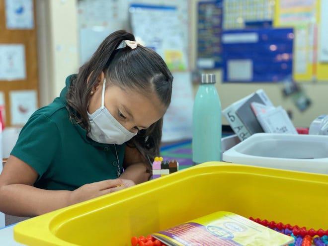 A kindergartner sudies at Colvin Elementary School in Wichita.