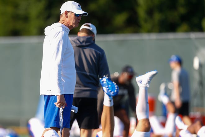 Kansas head coach Lance Leipold paces around his Jayhawks players at a practice one morning at the University of Kansas.
