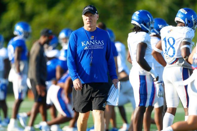 Kansas defensive coordinator Brian Borland walks on the field during a practice at the University of Kansas.