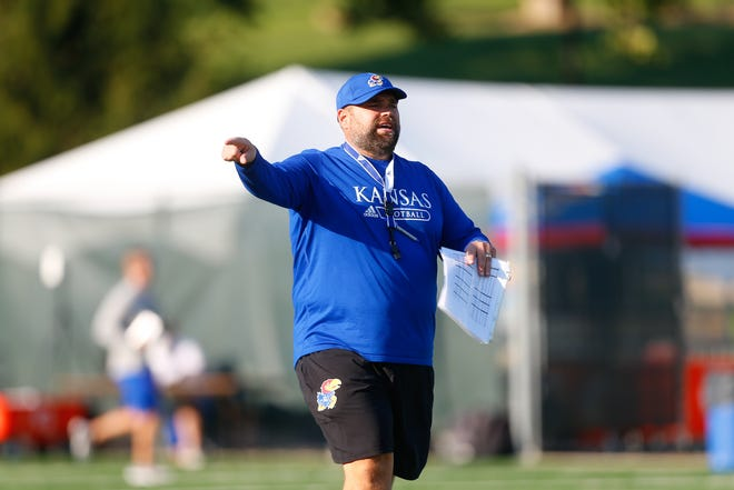Kansas offensive coordinator Andy Kotelnicki works with players during a practice at the University of Kansas.