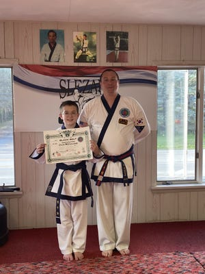 Colin McClelland, left, was recently promoted by Master Michael Slezak, right, to first-degree black belt July 8 at Slezak's Karate School in Somerset. Slezak's Karate School is a member of the Intercontinental Tang Soo Do Federation (I.T.O.) based in New Jersey.