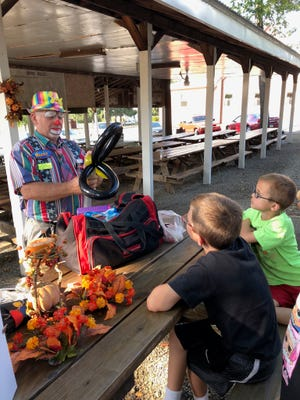 Christian clown Razzle entertains Waylan and Watson Mosgrave at the Geiger Church of the Brethren's annual Heavenly Harvest Hoedown in 2019. It's back!  Razzle, along with his partner Dazzle, will be wowing everyone again this year from 4 until 6 p.m. Sept. 18, at the church grove  Hayrides, games and campfires with hot dogs and s'mores will add to the fun. It's free. Each attendee is asked to bring a canned food or paper product donation to benefit the Somerset Food Pantry.