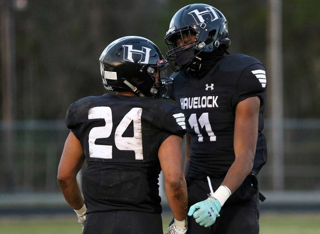 2023 Havelock tight end/linebacker Javonte Vereen (11) celebrates with a teammate during a March 19, 2021, home win over Jacksonville White Oak. Vereen, a 6-foot-4 junior, earned his first Division I scholarship offer from N.C. State last week.