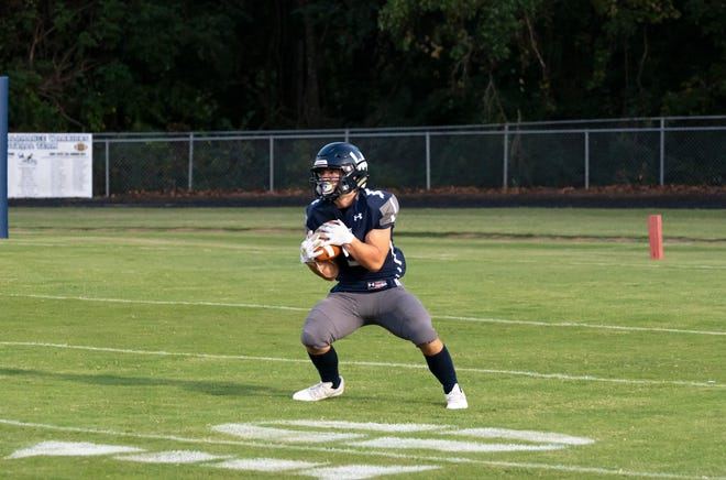Western Alamance junior Mason Hogsed catches a kickoff in a game against Northern Guilford last week.