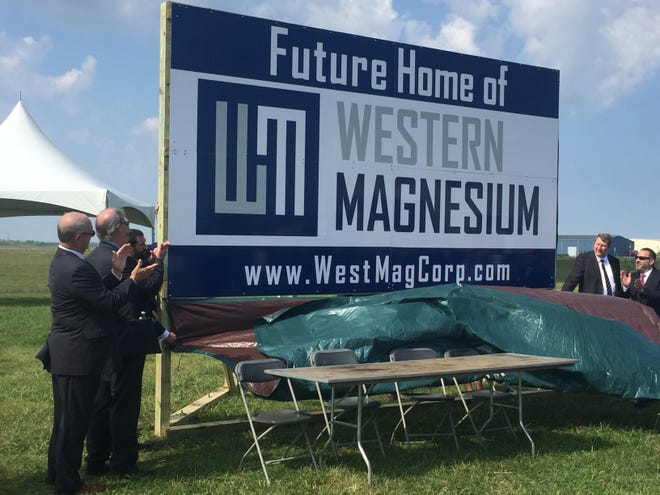 Officials unveil a sign to mark the site of Western Magnesium Corp.'s proposed plant at the Cadiz Industrial Park.