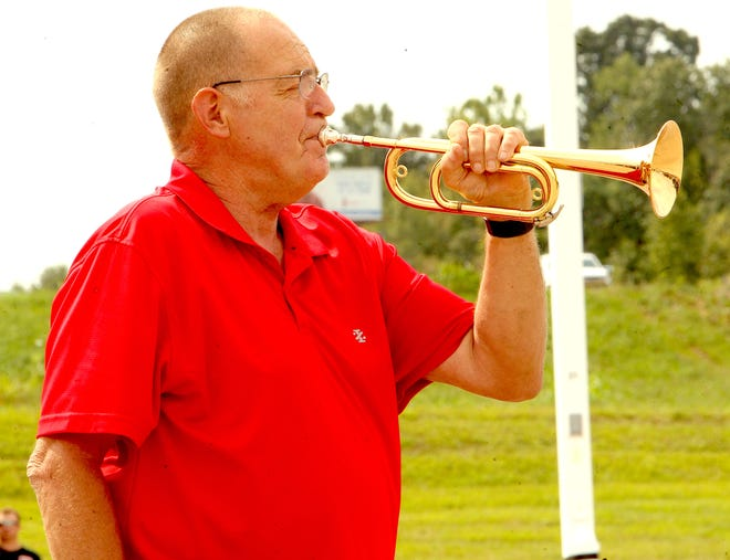 Roger Gales plays taps before the national anthem Saturday at the Lawrence County Cancer Patient Services car show. Gales will play taps at 8:46 a.m. on 9/11 on the west side of the Lawrence County Courthouse as part of national memorial organized by Taps for Veterans.