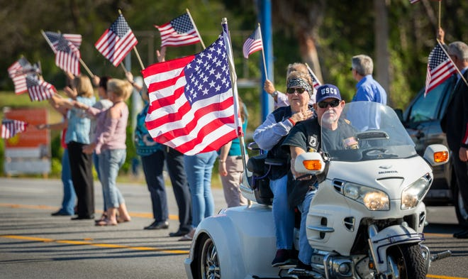 The Warrior Beach Retreat parade passes by the US Naval Diving & Salvage Training Center in Panama City Beach Tuesday, April 9, 2019. The weeklong retreat and parade honors soldiers injured in the Iraq and Afghanistan tours, along with their families.