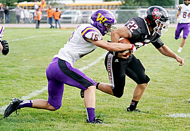 Watertown's Collin Dingsor strips the ball from Sturgis' Gunner Roholff during their season-opening high school football game Aug. 28 in Sturgis. After two road games, the Arrows will make their home debut on Friday when they host Brookings at 7 p.m. at Watertown Stadium.