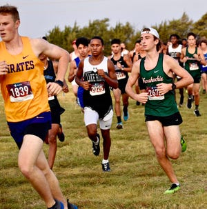 Waxahachie junior Braden Buegeler (right) competes in the James Smith Invitational cross-country meet in Midlothian on Thursday.