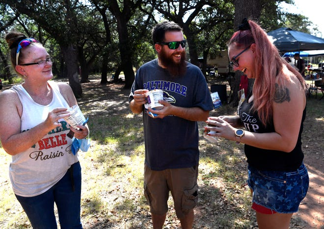 Vickie Rosario (left), Jack Blotner and Shanna Patrick sample bowls of chili Saturday. The 39th annual Chili Super Bowl & Brisket Cook Off was held at Old Settlers Reunion Grounds in Buffalo Gap.
