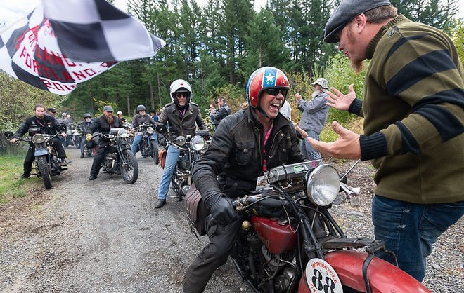Doug Wothke crosses the finish line at the Skamania Lodge on his 1928 Indian 101 Scout at the end of Motorcycle Cannonball coast to coast vintage run on Sunday, Sept. 23, 2018.