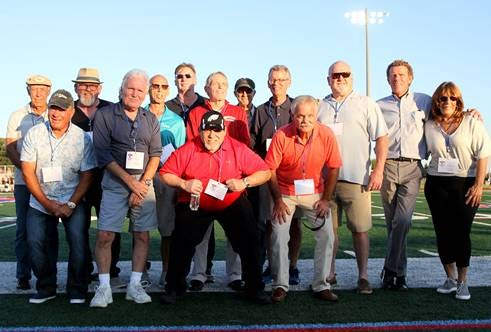 Members of the WTHS 1970 Undefeated Olympic Conference Championship squad, honored at the WTHS Minutemen season-opener on September 2nd, included: (Front Row, Left to Right): John Arena, Rick Haines, Fred Miller, Steve Hancock; (Back Row, Left to Right): Tim Mitcham, Dave Abrams, Rick Palmo, George Funk, Kevin Fleming, Rob Furstoss, Jack Pfizenmayer, Jim Morrison, Gary Pfizenmayer, Mary Domzalski (for Jack Domzalski, deceased)