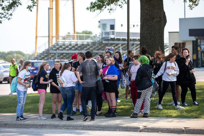 A group of students from Winterset Junior High walked out of class and gathered on the sidewalk, on Tuesday, Sep. 7, 2021, to show support for Lucas Kaufmann, a teacher who was put on administrative leave after using an image of a pride flag in a presentation to share information about himself with his students.
