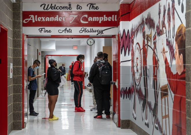 Ecorse High School students wait in for the start of their class during the first day at Ecorse High School in Ecorse on September 7, 2021.