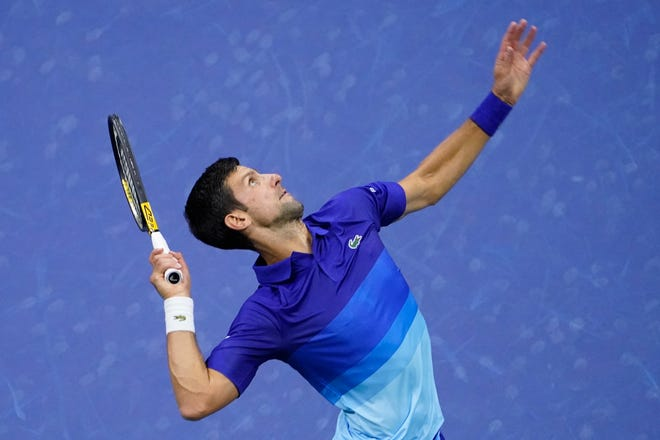 Novak Djokovic serves against Jenson Brooksby during the fourth round of the U.S. Open on Monday in New York.