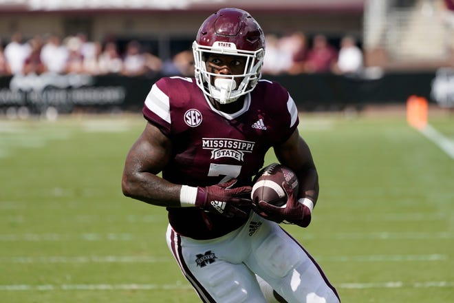 Mississippi State running back Jo'quavious Marks (7) looks upfield for running room after catching a short pass during the first half of an NCAA college football game against Louisiana Tech in Starkville, Miss., Saturday, Sept. 4, 2021. (AP Photo/Rogelio V. Solis)
