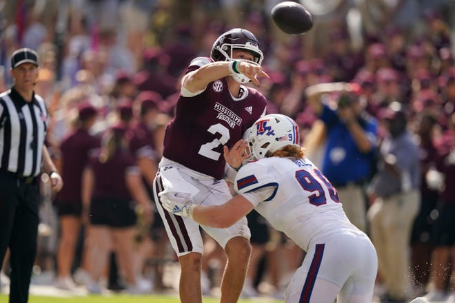 Mississippi State quarterback Will Rogers (2) is pressured by Louisiana Tech defensive lineman Ben Bell (96) as he passes against Louisiana Tech during the first half of an NCAA college football game in Starkville, Miss., Saturday, Sept. 4, 2021. Mississippi State won 35-34. (AP Photo/Rogelio V. Solis)