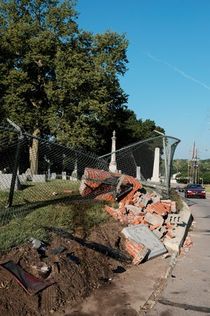 A brick pillar along the fence line of Greenbush Cemetery sits toppled over near the corner of Greenbush and 12th Streets, Tuesday, Sept. 7, 2021 in Lafayette.