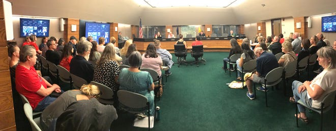 The public filled the Livingston County commissioners' meeting Tuesday, Sept. 7, 2021, with some of those attending being left to listen while standing in the entrance.