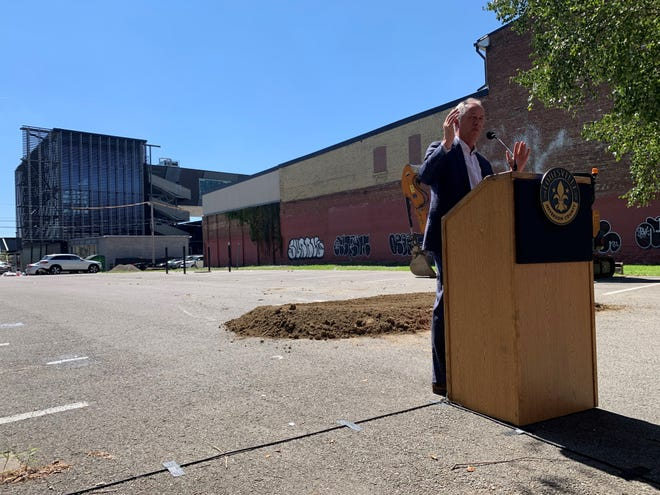 Louisville Mayor Greg Fischer speaks at a groundbreaking ceremony at a NuLu parking lot where a boutique hotel will be built. In the background is Rabbit Hole Distillery, which has partnered with developers on the project. Sept. 7, 2021