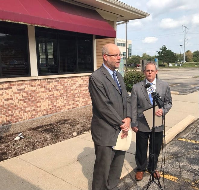 Attorneys Victor Forberger, left, and Paul Kinne announce a class-action lawsuit against the Department of Workforce Development over its denial of unemployment benefits for disabled workers.