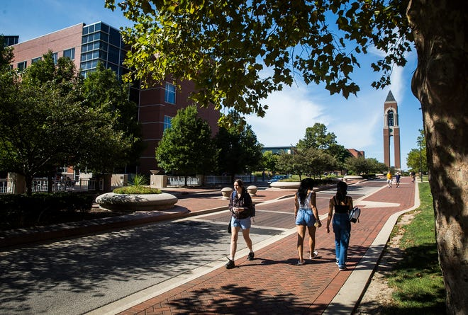 Students walk along McKinley Avenue on the Ball State University campus Thursday, Sept. 2, 2021.
